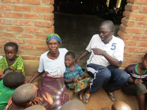 Davie, a KM board member, and Rubina, a volunteer, with the children.