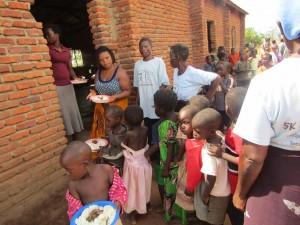 Yami passing out the food to the children.